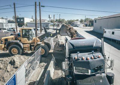 Front end loader removing dirt